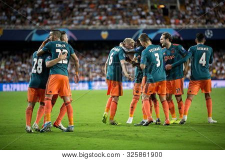 VALENCIA, SPAIN - OCTUBER 2: Ajax players celebratong goal during UEFA Champions League match between Valencia CF and AFC Ajax at Mestalla Stadium on Octuber 2, 2019 in Valencia, Spain