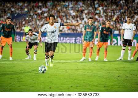 VALENCIA, SPAIN - OCTUBER 2: Parejo kicks a penalty during UEFA Champions League match between Valencia CF and AFC Ajax at Mestalla Stadium on Octuber 2, 2019 in Valencia, Spain