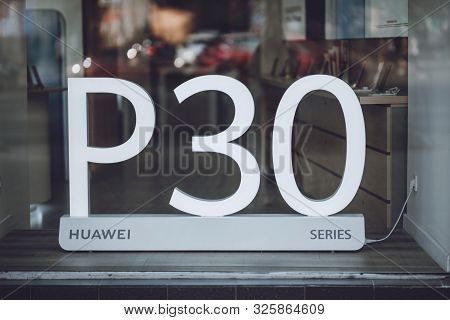 Huawei P30 Series Ad In Shop Window. Shop Sign Huawei. Kiev, Ukraine - September 02, 2019.