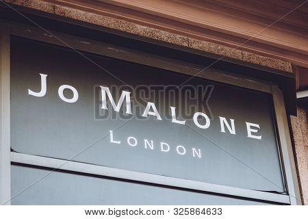 Jo Malone London Brend Sign On City Street. Signboard Logo Of Jo Malone London, British Perfume And