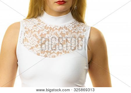 Blonde Woman Wearing White Top With Laced Detail On Cleavage. Fashion, Clothing Style Concept.