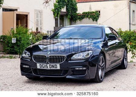 France Lyon 2019-06-18 Closeup Luxury Dark Blue German Car Sedan Premium Bmw 6 Series With Eu Regist