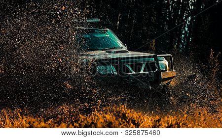 Mud And Water Splash In Off-road Racing. Drag Racing Car Burns Rubber. Extreme. Off-road Car. Tracks