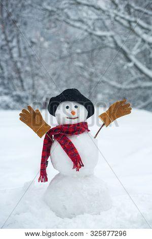 Christmas Snowman On White Snow Background. Winter Background With Snowflakes And Snowman. Snowman O