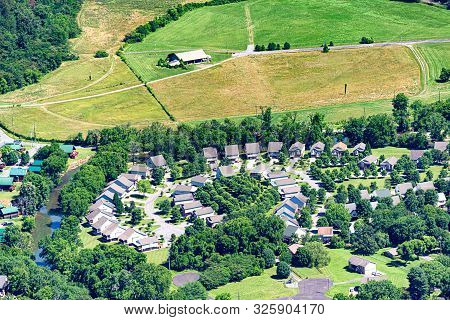 Horizontal Aerial Image Showing Urban Sprawl As New Homes Overrun Farm Land