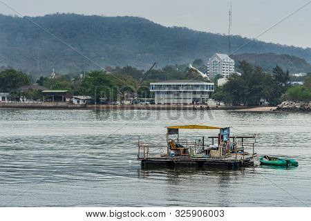 Si Racha, Thailand - March 16, 2019: Closeup Of Fishing Raft Floating On Bay Of Thailand Water With