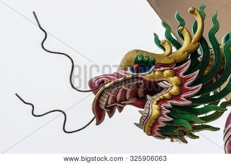 Si Racha, Thailand - March 16, 2019: Menacing Head Of Dragon At Guan Yin Circular Shrine On Edge Of