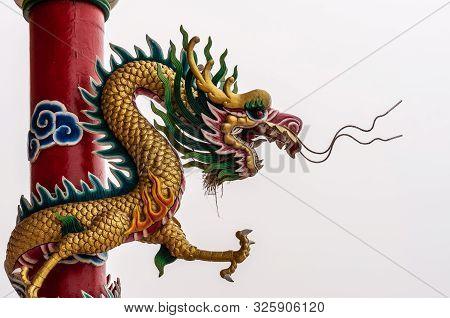 Si Racha, Thailand - March 16, 2019: Menacing Dragon On Red Pillar At Guan Yin Circular Shrine On Ed