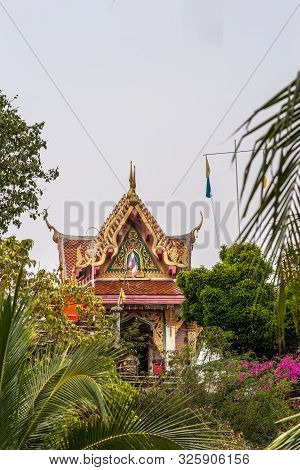 Si Racha, Thailand - March 16, 2019: Red And Gold Small Shrine Of Wat Koh Loy Buddhist Temple On The
