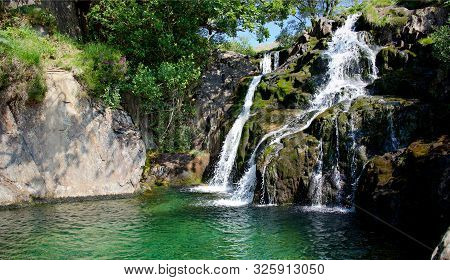 Clear Mountain Water Falling Into A Fairy Pool In North Wales