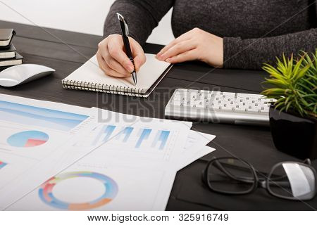 Close up of man accountant or banker making calculations. Close up of man accountant or banker making calculations. Savings, finances and economy concept poster