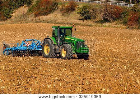 Cebin, Czech Republic - October 1, 2019: Tractor John Deere On The Field. Cultivation For Loosening