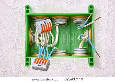 poster of Electric installation work. Conductor splicing connectors type of push lever. Wire connectors for connecting cables of domestic wiring. 5 ports push lever terminal block wire connector.