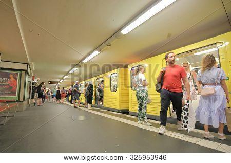 Berlin Germany - June 11, 2019: Unidentified People Travel By Subway At Potsdamer Platz Station Berl