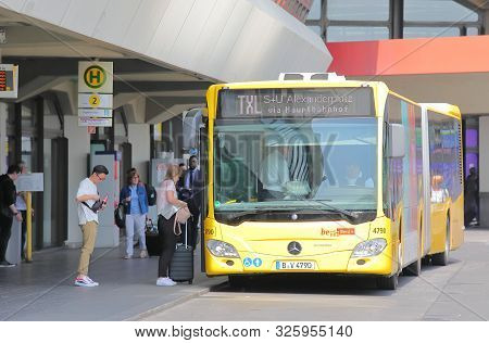 Berlin Germany - June 12, 2019: Unidentified People Travel By Txl Airport Shuttle Bus At Tegel Airpo