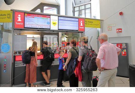Berlin Germany - June 12, 2019: Unidentified People Queue At Berlin Tegel Airport Tourist Informatio