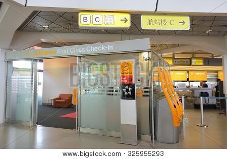 Berlin Germany - June 12, 2019: Unidentified People Work At Lufthansa First Class Check In Counter B