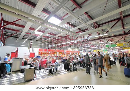 Berlin Germany - June 12, 2019: Unidentified People Travel At Tegel Airport Berlin Germany