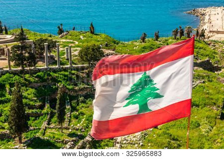 Lebanese Red And White With Green Cedar Tree Flag Waving On The  Wind With Sea In The Background, By