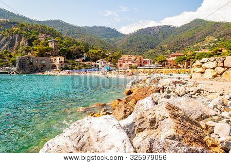 Monterosso Al Mare, Italy - September 02, 2019: Rocky Marina And The Beach Full Of People With Color