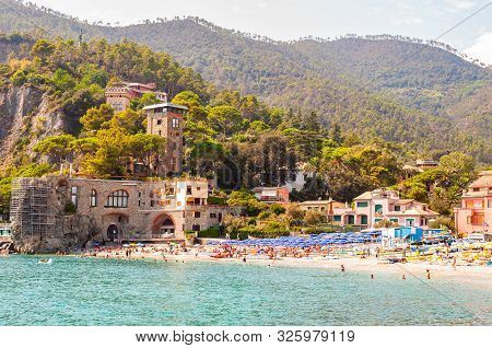 Monterosso Al Mare, Italy - September 02, 2019: The Beach Full Of People, Colorful Waterfront Buildi
