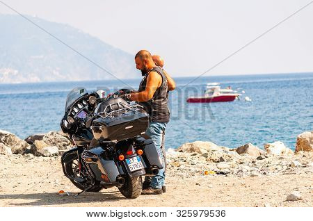 Monterosso Al Mare, Italy - September 02, 2019: Two Men, Bikers Arrived And Standing Near The Bike O