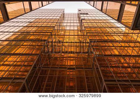 Tsim Sha Tsui, Hong Kong : September 21, 2019 : Gold Glass Mirror Of Contemporary Buildings In Hong