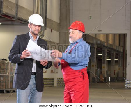 Developer And Senior Worker With Blueprints