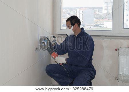 Worker Cuts Concrete