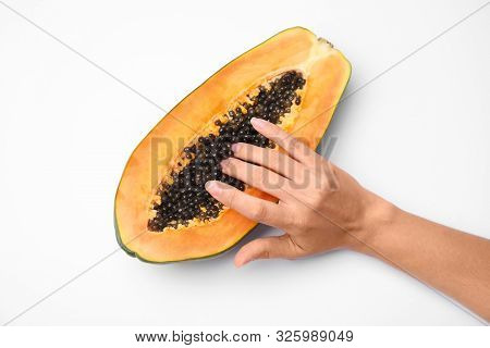 Young Woman Touching Half Of Papaya On White Background, Top View. Sex Concept