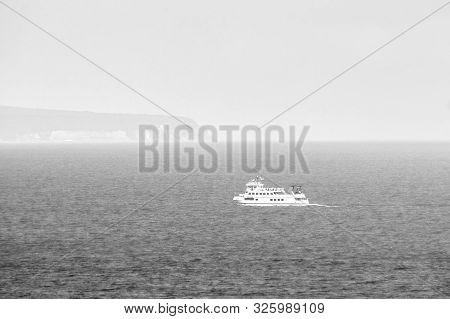 Baltic Sea Ferry Enters The Fog Off The Coast Of The German Island Ruegen, Alarming Atmosphere, Blac
