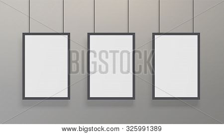 Realistic White Poster Mockup With Black Frame. Blank Vertical A4 Formats Paper Poster At The Grey W