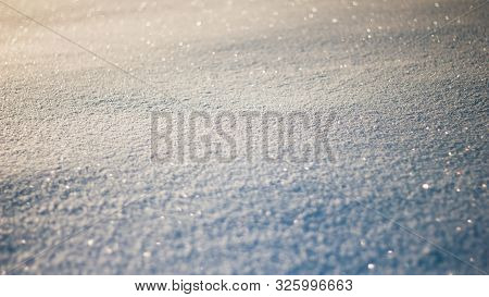 Snowy White Background. The Texture Of The Snow. Shiny Snow With Bokeh And Blurred Background Close-