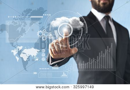 Businessman Standing And Working With Touch Screen Technology  - Earth Map From: Http://eoimages.gsf
