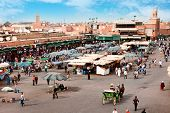Djemaa el Fna - square and market place in Marrakesh's medina quarter, Marrakesh, Morocco. poster