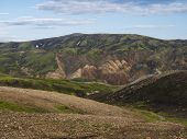 Colorful Rhyolit mountain panorma with multicolored volcanos in Landmannalaugar area of Fjallabak Nature Reserve in Highlands region of Iceland poster