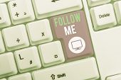 Text sign showing Follow Me. Conceptual photo Inviting a demonstrating or group to obey your prefered leadership White pc keyboard with empty note paper above white background key copy space. poster