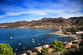 Beautiful beach with boats , cliffs and mountains in La Azohia village in Cartagena, Murcia, Spain in a sunny day. Views from Santa Elena tower viewpoint. poster