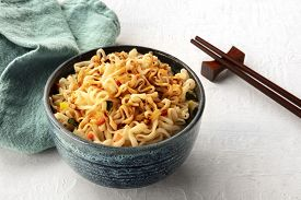 Instant Soba Noodles With Carrot, Scallions, And A Sauce, A Close-up With Chopsticks And A Place For