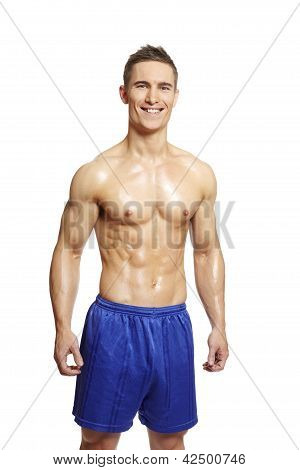 Muscular Young Man Flexing Arm In Sports Outfit