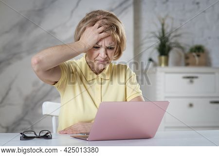 Portrait Of Angry Stressed Elderly Senior Woman, Tired Lady Having Problems With Using Her Broken La