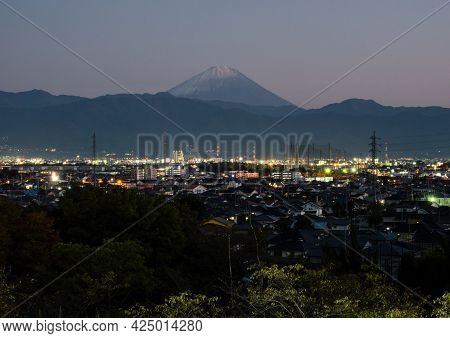 Nighttime View Of Kofu City With Mount Fuji On The Background - Yamanashi Prefecture, Japan