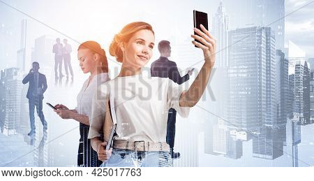 Businesswoman In Casual T-shirt Using Smartphone, To Communicate With Business Colleagues On The Dis