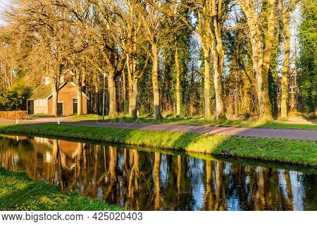 Canal And Trees At Entrance Of In Veenhuizen In The Netherlands