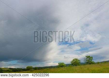 Summer Landscape On Field Before The Storm. Awe Clouds Before The Rain