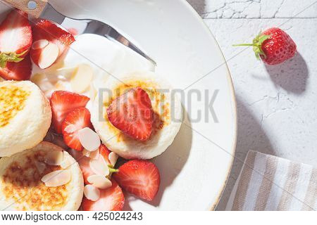 Homemade Cottage Cheese Fritters - Syrniki With Strawberries And Sour Cream, Russian And Ukrainian C