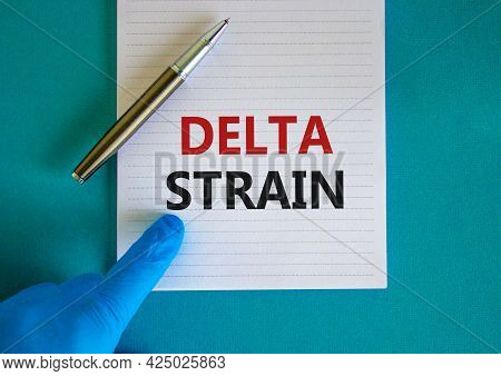 New Covid-19 Delta Variant Strain Symbol. Hand In Blue Glove With White Card. Concept Words 'delta S
