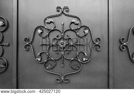 Forged Metal Pattern On A Floral Theme On A Metal Fence