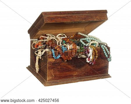 Antique Wooden Box With A Key Filled With All Kinds Of Beads, Ornaments And Bijouterie Isolated On A