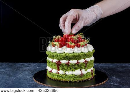 Delicious Schnipinat Cake With Cream, And Strawberries. The Creation Process. Natural Products For C